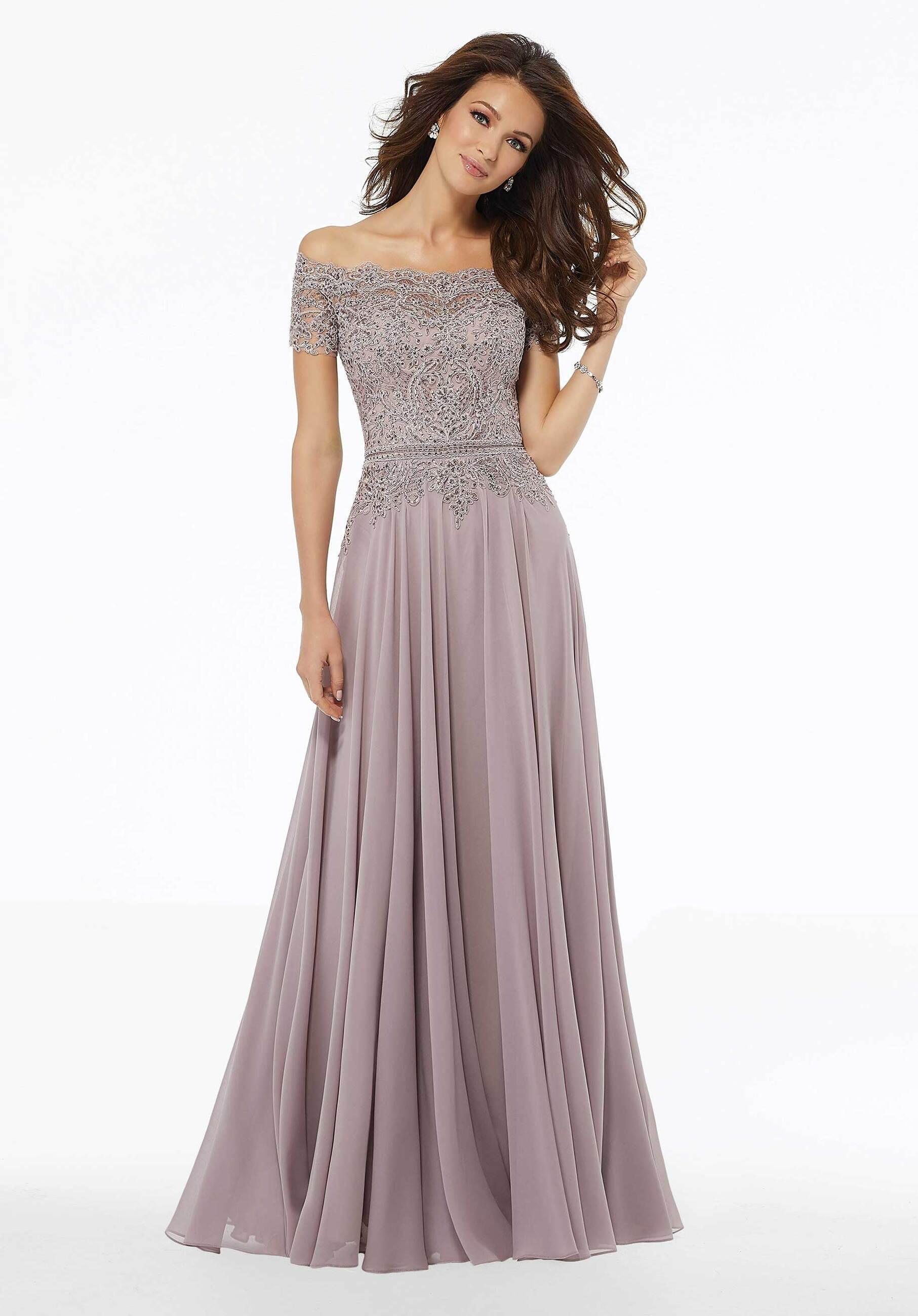 Model wearing a Morilee Damas dress