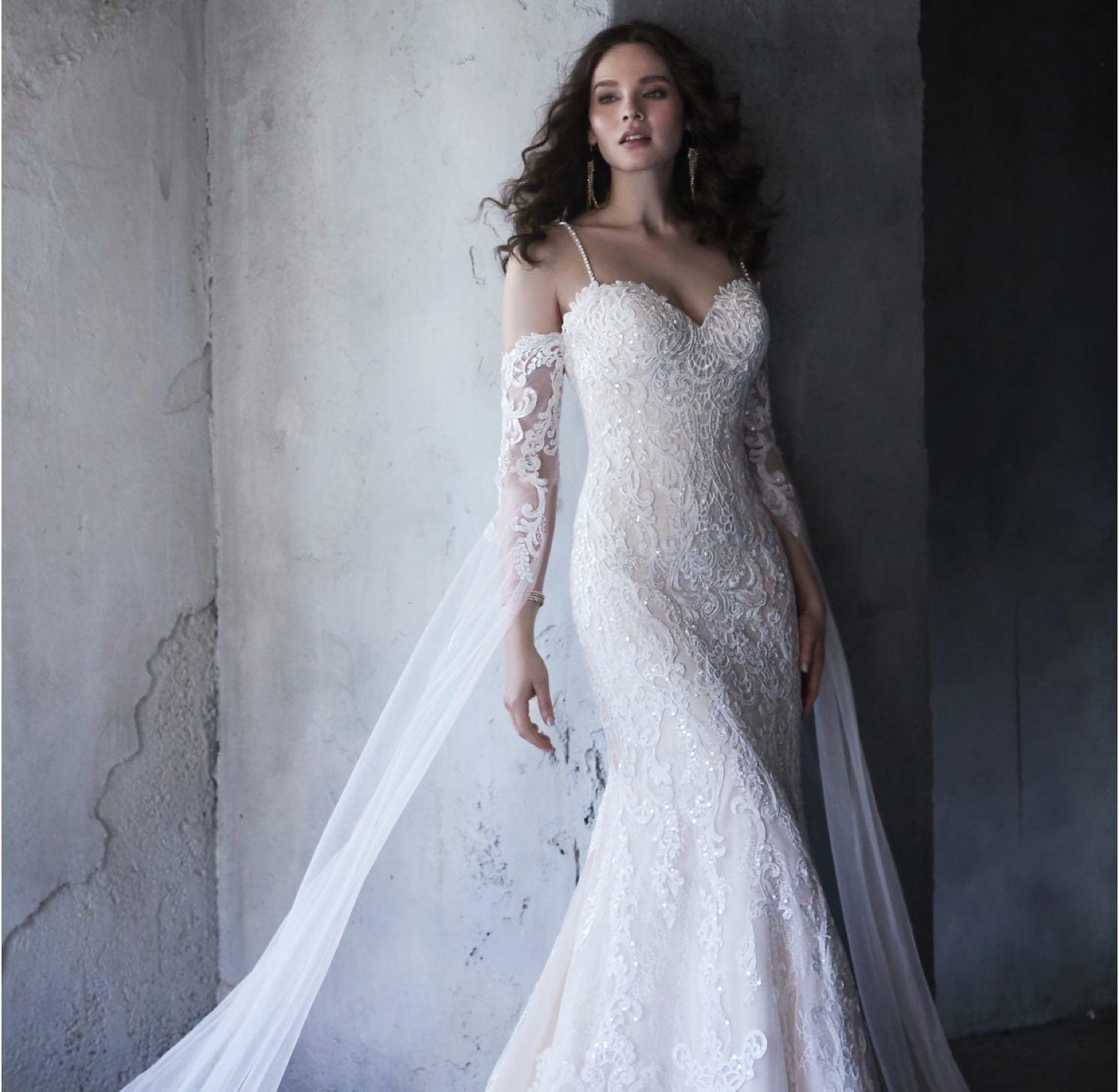Model wearing a white Morilee dress