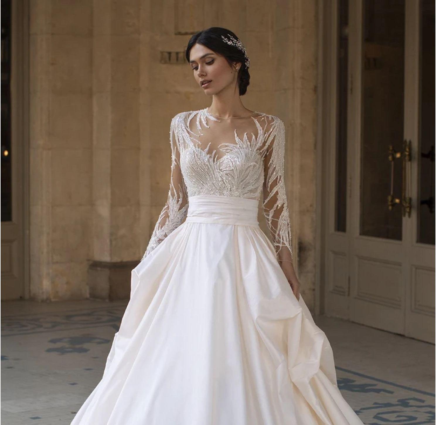Model wearing a white Maggie Sottero dress